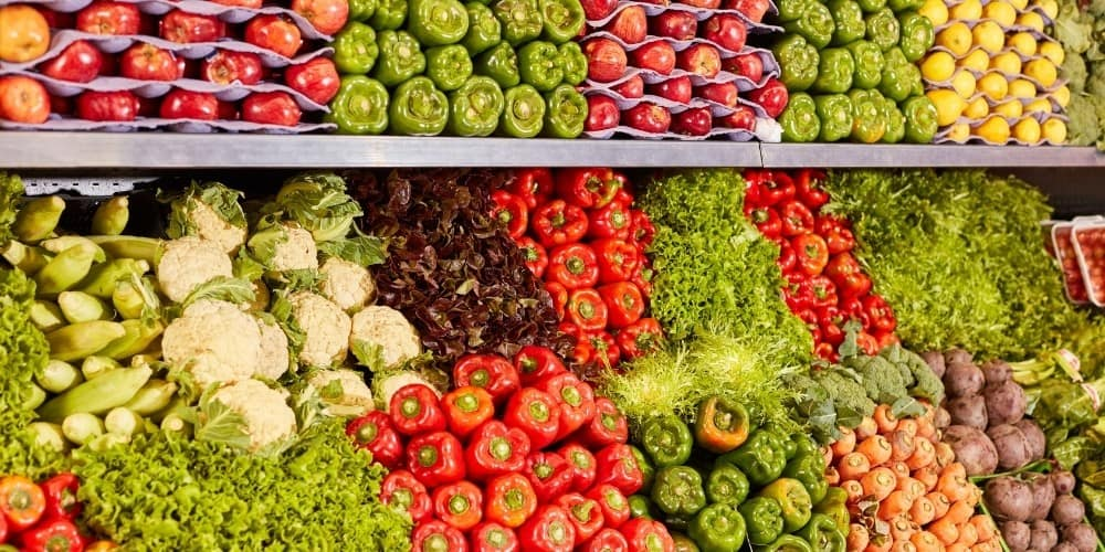 A large variety of vegetables offered for sale at a supermarket.